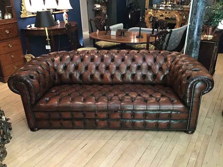 A super example of a mid-20th century brown leather Chesterfield sofa with buttoned seat and back.  The buttoned seat examples being rarer, more desirable and aesthetically pleasing than those with cushions. Good chesterfields from this period