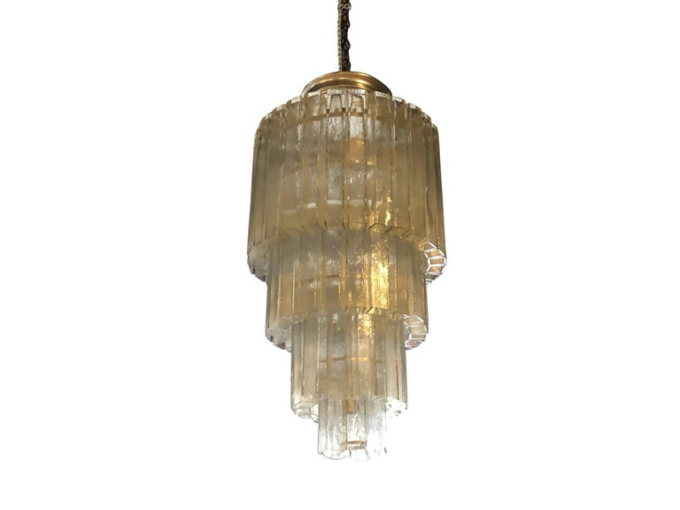 A rare Murano chandelier, made out of tubes of crystal square on four nickel metal frame, sixteen light sockets. The crystal glasses are ice transparent and in three different sizes. Minor damages on two crystal glasses, due to age, circa 1960