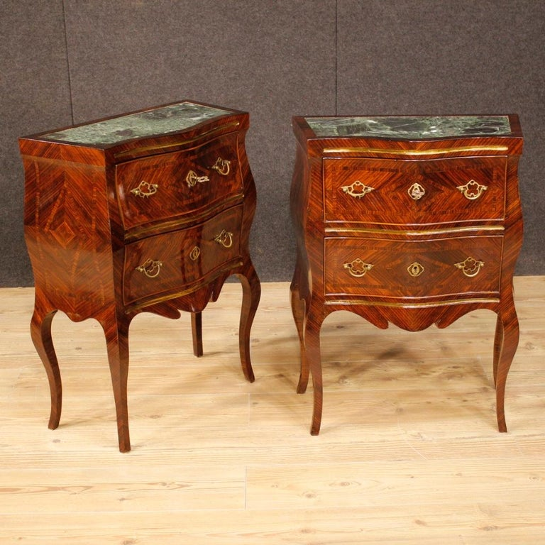 Pair of Sicilian nightstands from the early 20th century. Furniture in violet wood, elegantly inlaid. Bedside tables with two front drawers of good capacity and service, complete with two working keys, adorned with handles and decorations in gilded