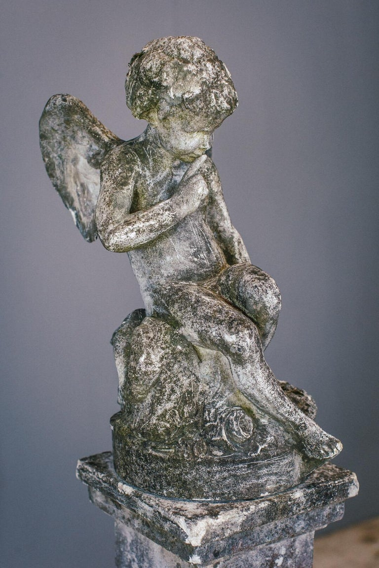 Weathered Angel statue and plinth. Wonderful patination and lichen growth. Composite.