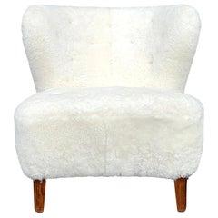 20th Century White Sheepskin, Swedish Beechwood Lounge Chair by Gösta Jonsson