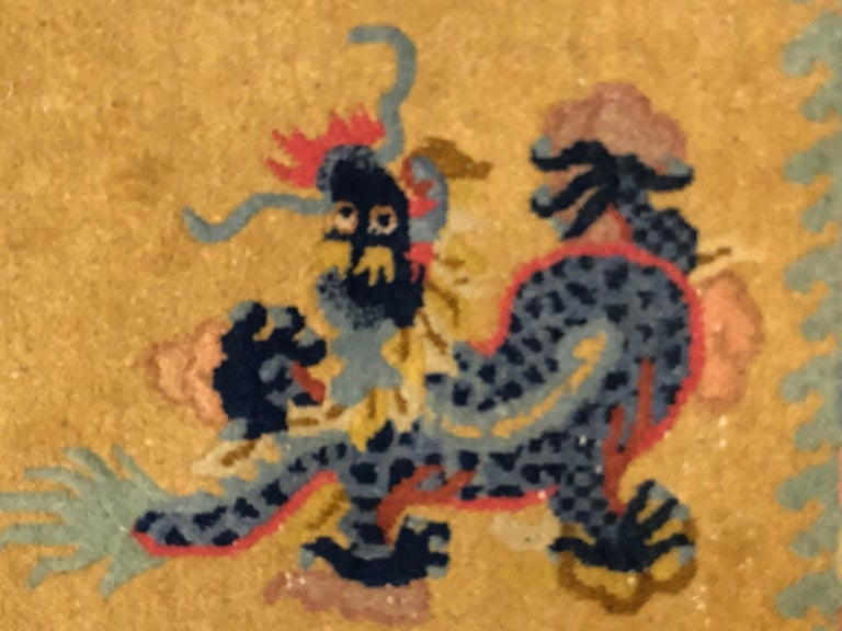 Rare Chinese carpet for the color of lemon yellow background. The subject of the decoration is that of the dance of the dragons, enriched by an important border where the Buddhist symbols of the good wishes are represented. The infinite knot that is
