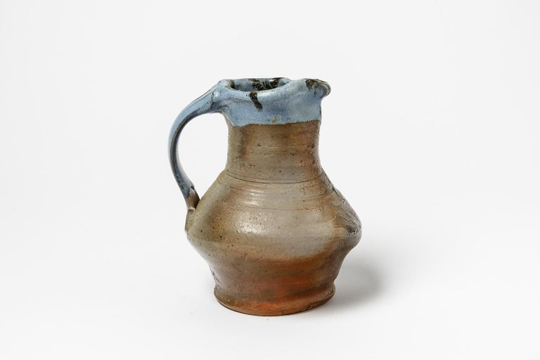 Jean Linard  circa 1975, signed under the base LINARD  Original blue and brown ceramic pitcher by French artist  Excellent original condition  Measures: Height 18cm, large 15cm  Pair is available.