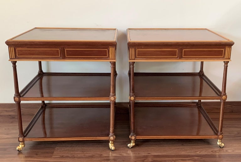 A beautiful French side or end table, telephone table supported by small brass caster wheels. Two large drawers in each table and two shelves. The wheels and drawers works perfectly.