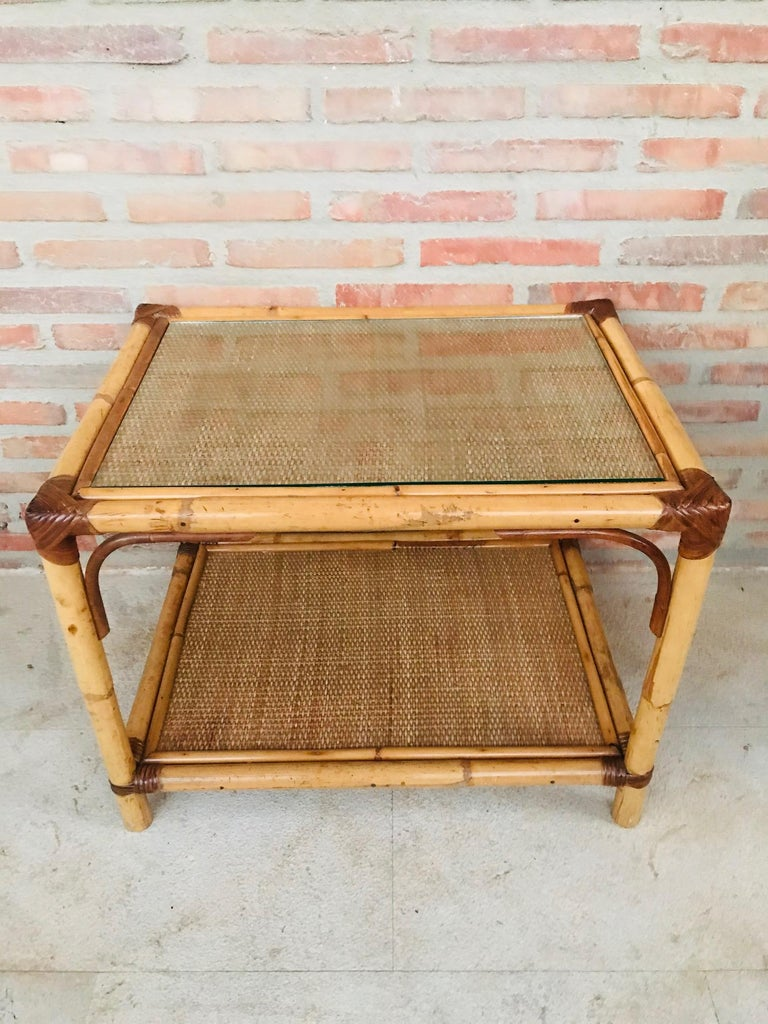 20th century Spanish rectangular bamboo coffee table with glass top.