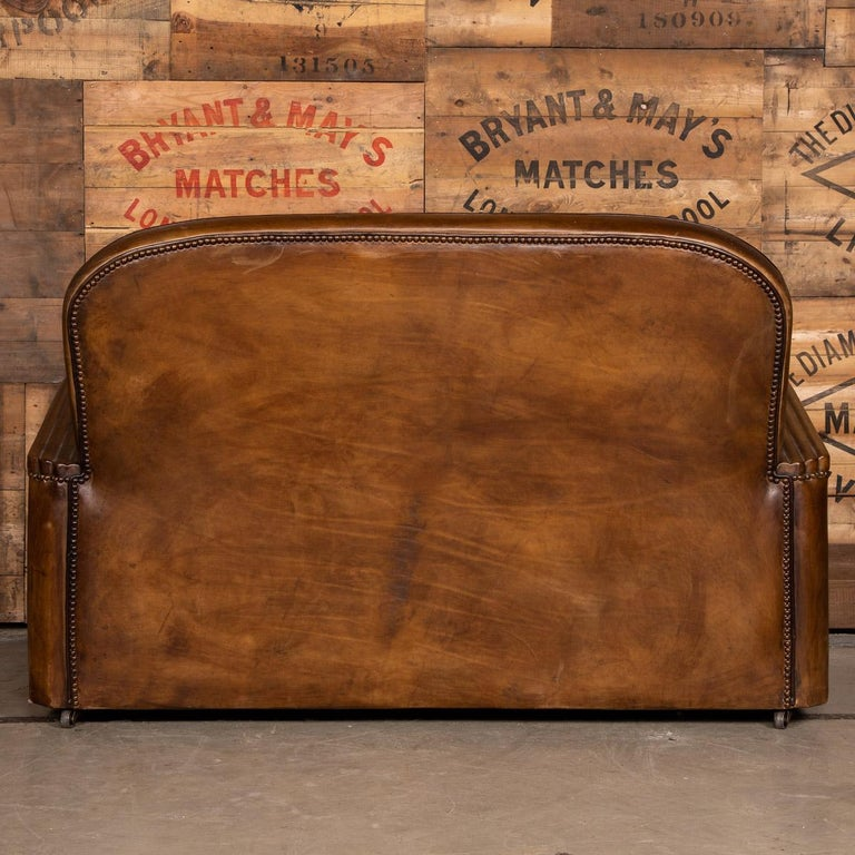 20th Century Art Deco Pair of Leather Tub Chairs and Sofa, circa 1920 In Good Condition For Sale In London, London