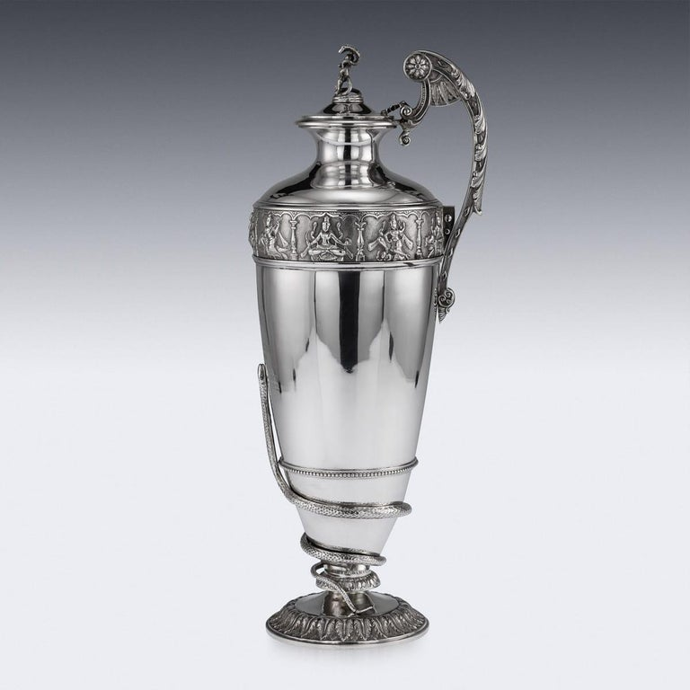 Antique early 20th century Indian Colonial solid silver regimental (28th Regiment) commemorative wine ewer, the top band is beautifully chased and repousse' decorated depicting Hindu gods and goddesses in elaborate cartooches, and the bottom applied