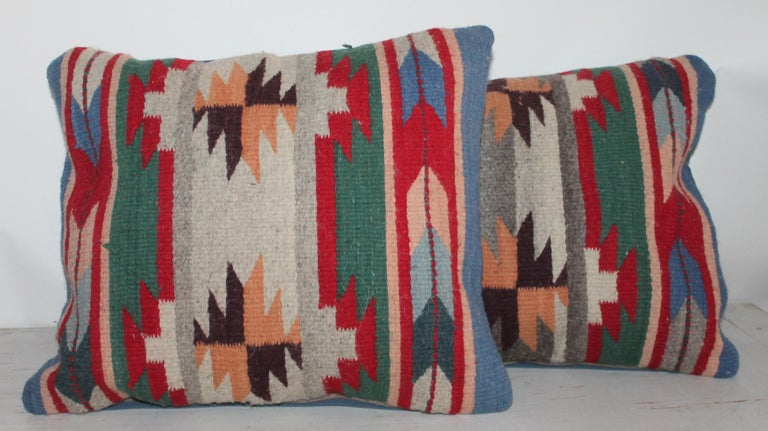 These Indian weaving pillows have blue linen backings. These pillows are made from Mexican / American Indian weaving's. Sold in pairs.