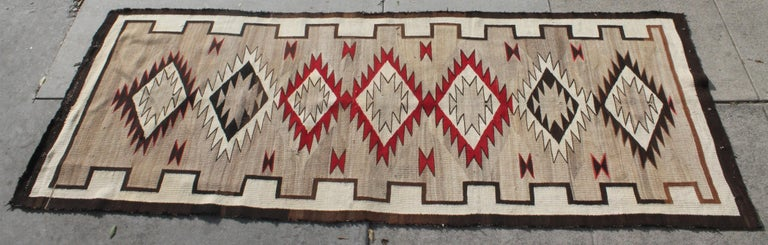 Navajo runner eye dazzler weaving in very good condition. Professionally cleaned and very rare to find Navajo runners of this quality and condition. Minor repair to one edge.