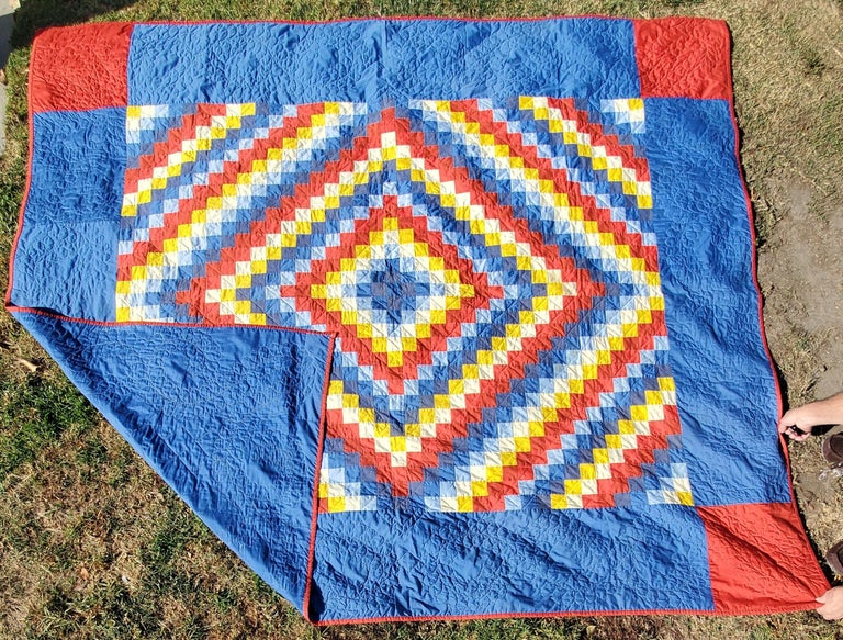 This finely quilted and pieced Philadelphia pavement quilt is in very good condition. The quilt is similar in pattern like a sunshine and shadow. The red corner blocks are a nice finishing touch. This quilt is all cotton and comes from Lancaster