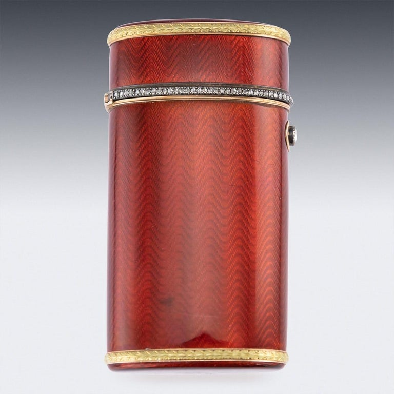 Antique early 20th century imperial Russian Faberge cigarette case, applied with vibrant red guilloche enamel on silver, richly silver-gilt throughout, the flange mounted with a row of old rose-cut diamonds, a diamond-set thumbpiece, borders applied