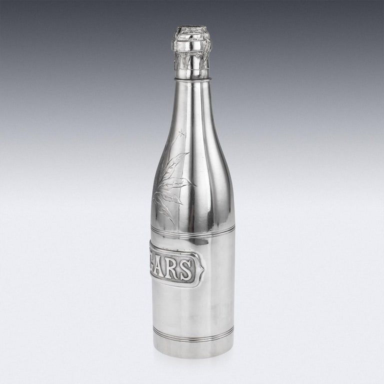 Antique early-20th century novelty silver plated champagne bottle shaped cigar holder, decorated with a tobacco leaf and a cigars sign, the bottle is made up of various screwed on compartments for cigars, tobacco and matches. Stamped on the base by