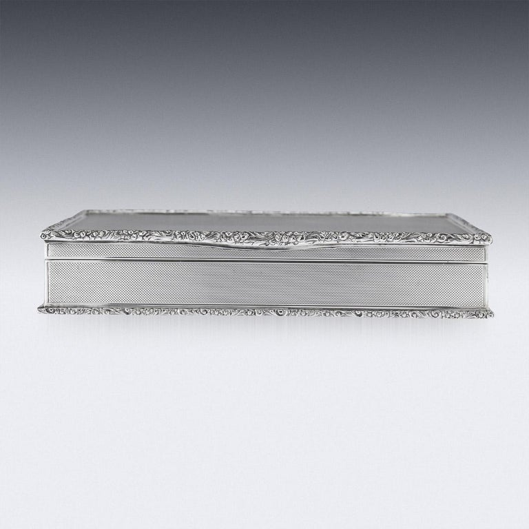 Elegant mid-20th century solid silver cigar box, beautiful and very stylish engine-turned design, applied with a cast scroll boarders, inside richly gilt and wooden lining, the base is lined with black leather. Hallmarked English silver (925