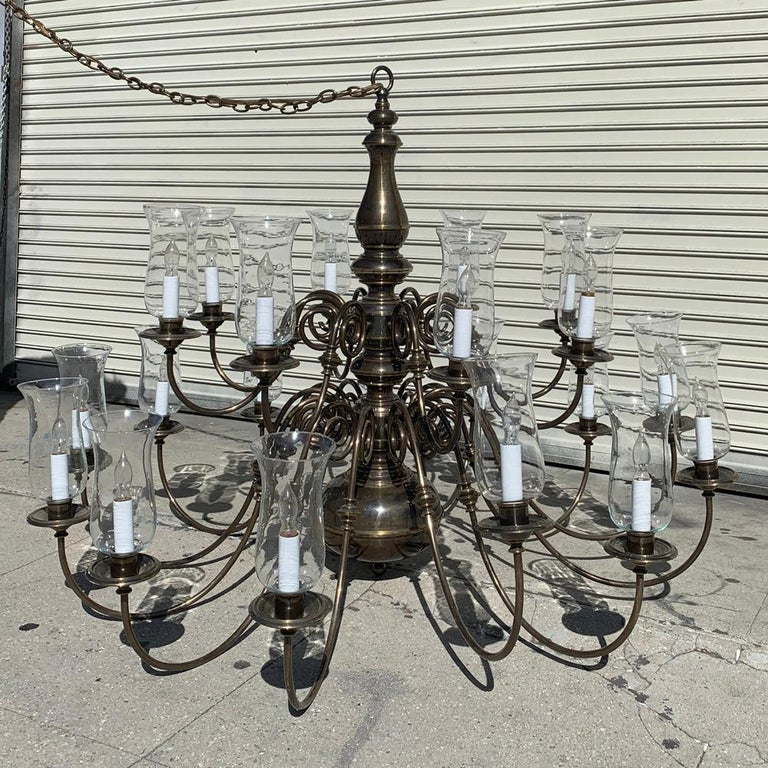 Beautiful chandelier with 21 arms made in solid brass, designed and manufactured in the USA by Feldman Lighting in the early 1980s.  The chandelier was installed at a church since it was ordered in the early 1980s and removed just a couple months