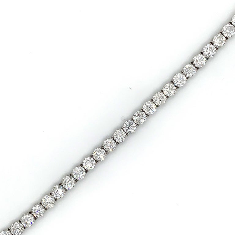 This one of a kind tennis bracelet from Issac Nussbum New York features 31 ideal brilliant cut diamonds set in hand made platinum. The diamonds in this stunner are E-G color and si clarity. With a 21.90 total carat weight   Feel free to reach out to