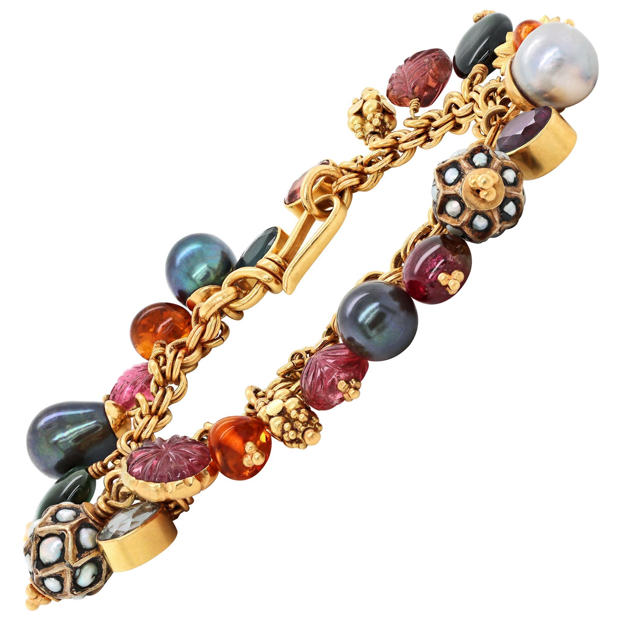 21 Carat Yellow Gold Multi-Gemstone Charm Bracelet