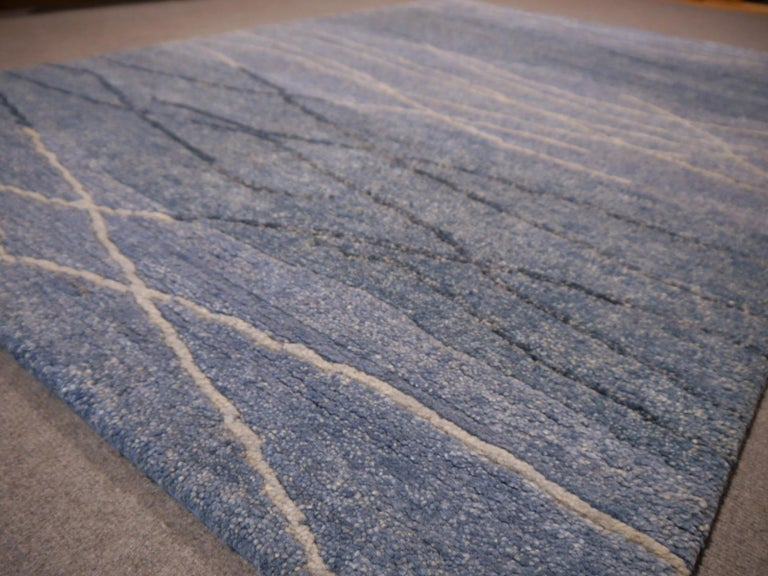 A beautiful new 21 century design carpet, hand knotted using finest Tibetan Highland Wool. 