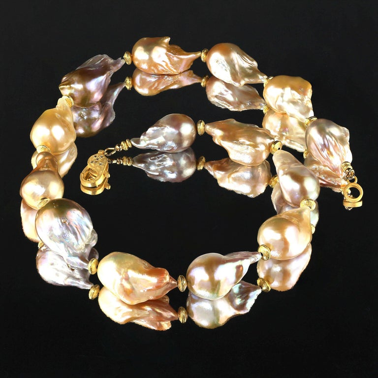 Necklace of luscious, lustrous natural multi tone Baroque Pearls with gold accents.  These huge, 30 x 18 MM, Baroque Pearls are gorgeous and complement all skin tones.  This unique necklace features a vermeil (gold over Sterling Silver) lobster claw