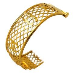 21 Karat Yellow Gold Vintage CC Motif Open Bangle Bracelet