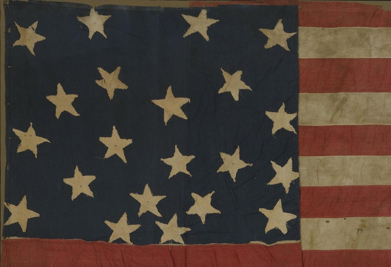 Presented is an impressive 21-star flag circa 1860-1865. This is a southern-exclusionary 21-star flag constructed during the period of the American Civil War. The number of stars on this flag represent the number of states that remained loyal to the
