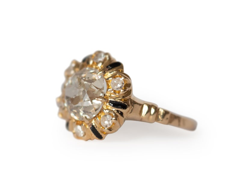 Ring Size: 6.5 Metal Type: 14K Yellow Gold  [Hallmarked, and Tested] Weight:  3.5 grams  Center Diamond Details: Weight: 2.10 carat Cut: Old Mine Brilliant (Antique Cushion) Color: M Clarity: I1  Side Diamond Details: Weight: .20 carat, total