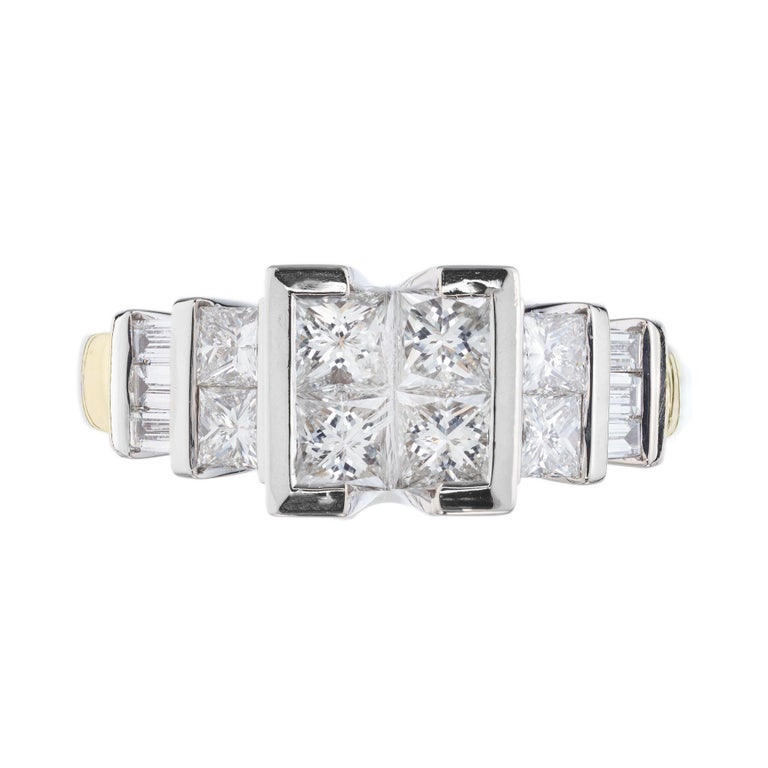 Raised center crown with 4 invisibly set Princess cut diamonds accented with 6 emerald and princes cut diamonds in a 14k white and yellow gold setting.   8 Princess cut diamonds approx. total weight 1.60cts 6 emerald cut diamonds approx. total
