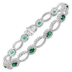 Grandeur 2.13 Carat Oval Cut Emerald and Diamond 14K White Gold Tennis Bracelet