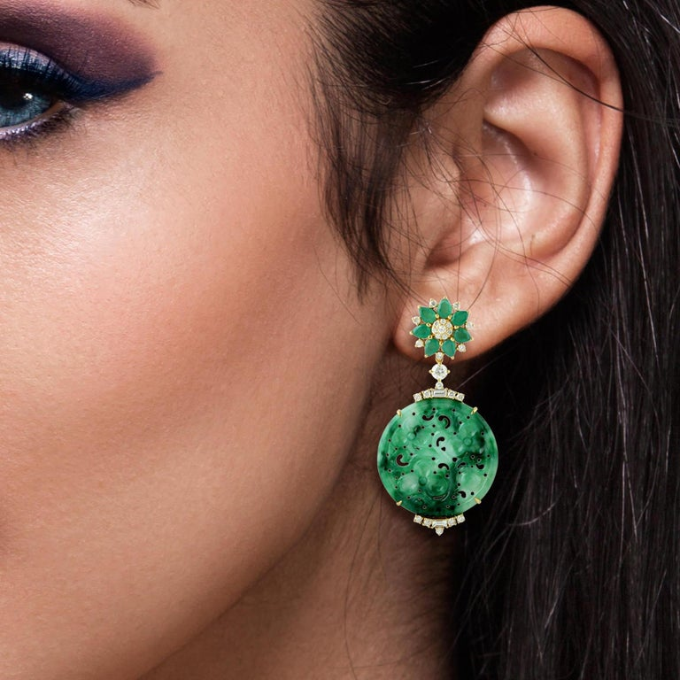 These stunning hand carved Jade earrings are crafted in 18-karat gold. It is set in 21.48 carats Jade, 1.94 carats emerald and 1.15 carats of sparkling diamonds.  FOLLOW  MEGHNA JEWELS storefront to view the latest collection & exclusive pieces.