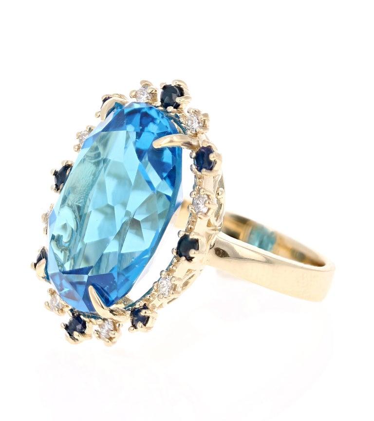 Modern 21.50 Carat Oval Cut Blue Topaz Diamond 14 Karat Yellow Gold Cocktail Ring For Sale