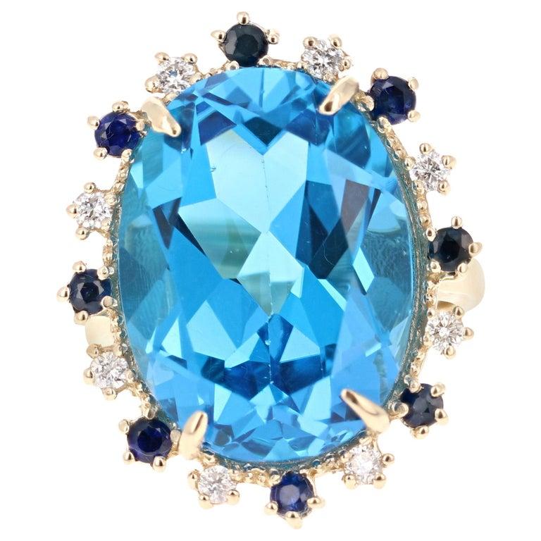 21.50 Carat Oval Cut Blue Topaz Diamond 14 Karat Yellow Gold Cocktail Ring For Sale