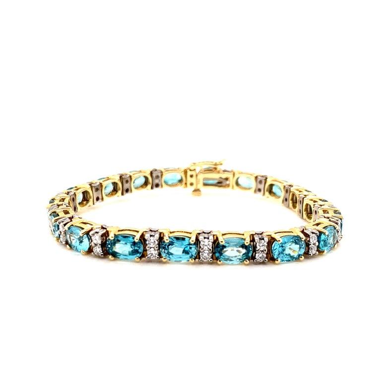 Oval Cut 21.50 Carat Blue Zircon and Diamond Bracelet For Sale