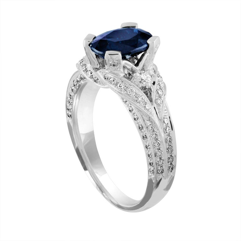 Beautiful Blue Sapphire Ring. The ring is 18K White Gold. The Blue Sapphire is Oval 2.16 Carat. The stone is Heated. There are 0.75 Carat Diamonds F/G VS/SI. The ring is a size 6.75, sizable. The ring weighs 6.3 grams
