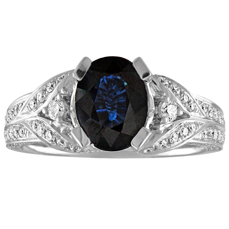 2.16 Carat Oval Blue Sapphire Diamond Gold Ring For Sale