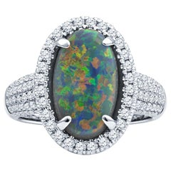 2.16ct Australian Multicolor Opal with 0.62ctw Diamond Halo Ring, 18k White Gold