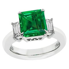2.18 Carat Colombian Emerald 0.63 Carat Diamond Engagement Ring