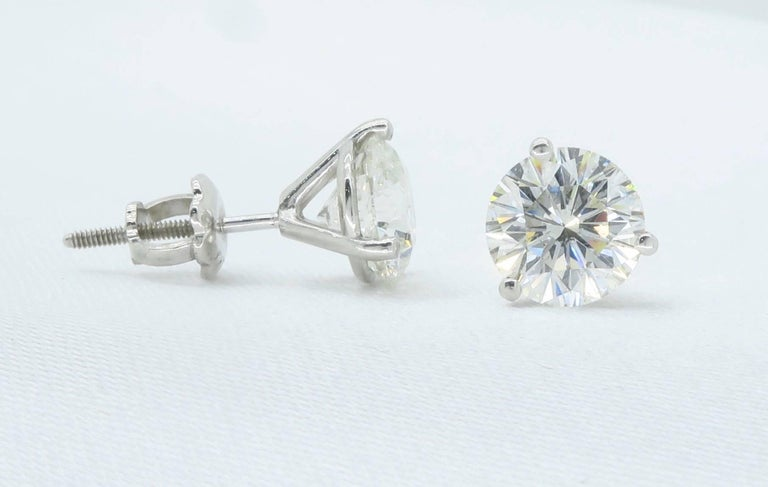 This Beautiful Pair Of Leo Diamond Earrings Feature One 1 10ct Round With G H