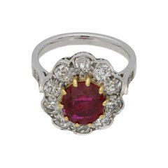Ruby and Diamond Cluster Engagement Ring set in Yellow Gold and Platinum