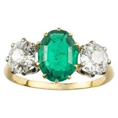 2.19 Carat Oval Emerald Diamond Gold Three-Stone Ring