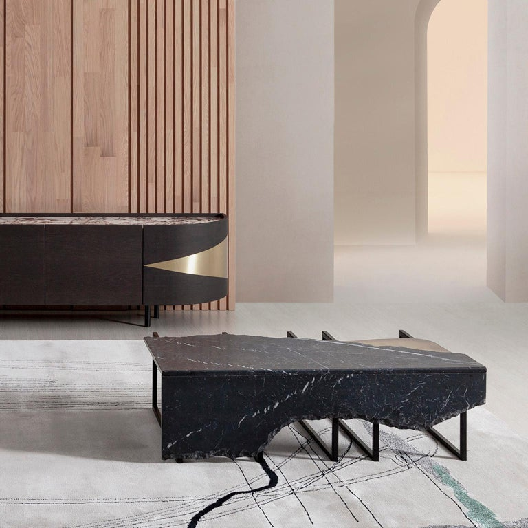 Coffee table top in matt Nero Marquina marble with a split face effect on the edge and an inlay metal detail in dark oxidised brass with a high-gloss finish. Metal structure base lacquered in satin black.  Aire coffee table Medium  FI007 Black