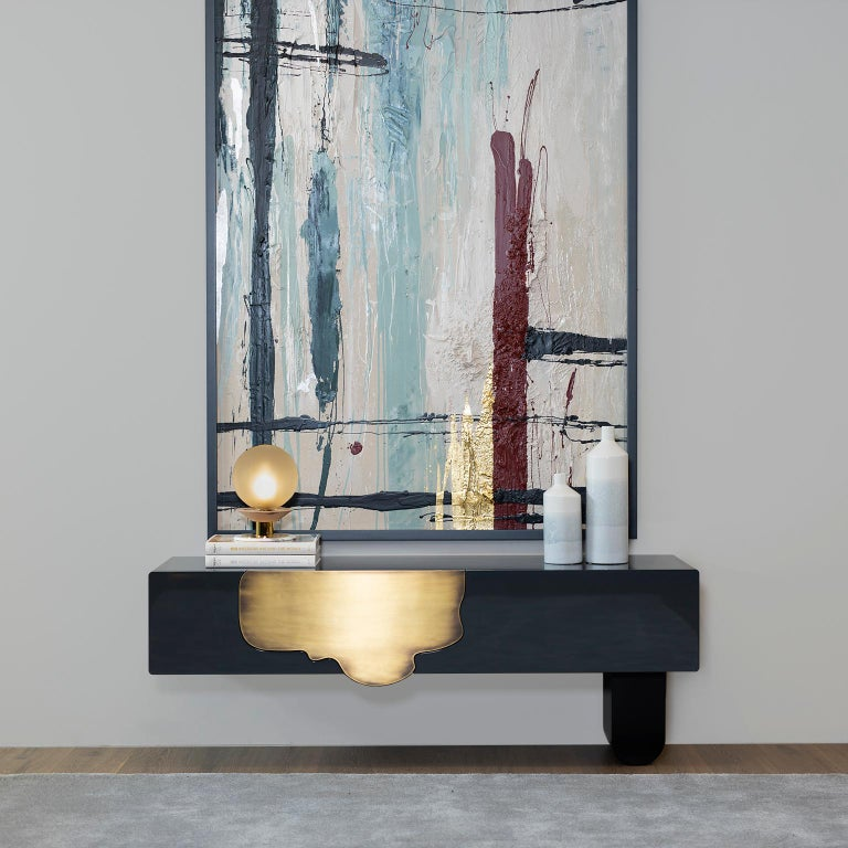 Wooden console lacquered in high-gloss dark blue-grey with two-drawer compartments. Front drawer panel in dark oxidized brass with a high-gloss finish. Wooden leg lacquered in satin black.  Alma console  FI145 dark blue-grey, high-gloss
