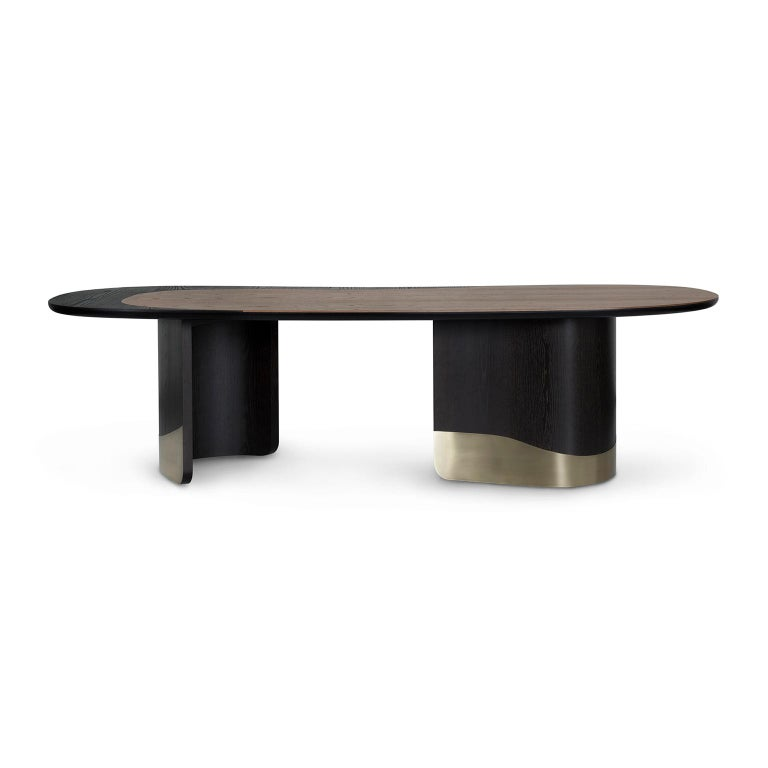 Dining table bean-shaped top with inlaid two veneers: American oak in open-pore tobacco color stained and ash in open-pore dark brown stained, both with an eggshell finish. Table top round edge lacquered in satin black. Two semicircular bases in