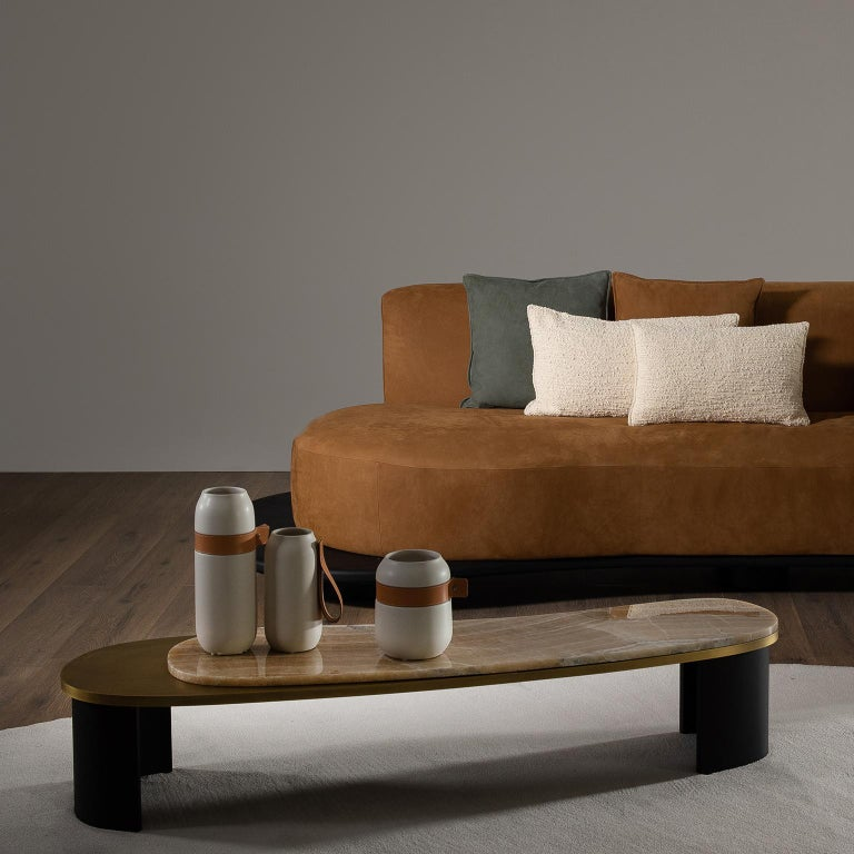 Wooden coffee table with top in dark oxidized brass with matt finish and polished shadow onyx. Semicircular legs in American oak veneer open-pore black stained with matt finish.  Coffee table Armona  WD107 American oak; open-pore black stained;