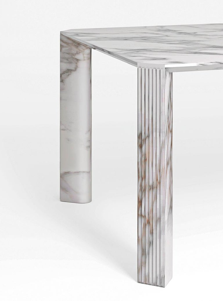 21st century Art Deco Elie Saab Maison calacatta gold marble dining table, Italy.  Precious materials are key in theElie Saab Maison collection, such as the noble marbles and stones that present the most iconic pieces. The Canova Dining Table, in