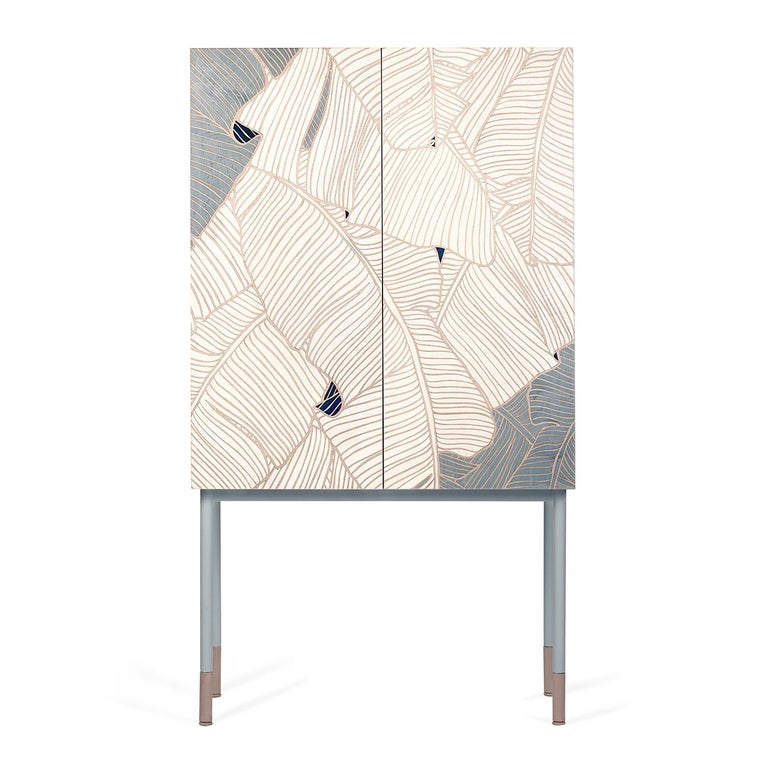 Marked by a delightful palette of white and blue colors, Basjoo is inspired by the unattainable perfection of nature. Every detail of this piece of furniture smells of exotic nature, of tropical forests, of light filtered by the fresh leaves of the