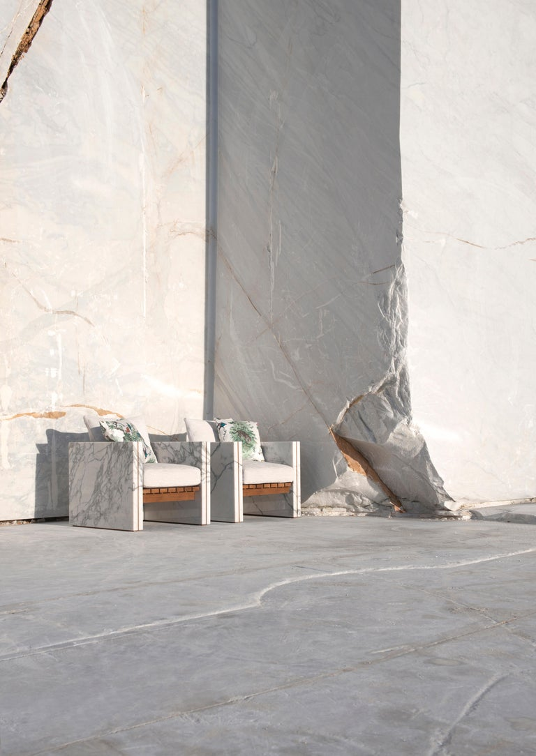 Bettogli Armchair is made in Statuario marble, a rare quality of marble that is extracted from the Bettogli quarries in North Tuscany where it gets the name from.  The combination of the Statuario marble with the precious teak expresses a tendency