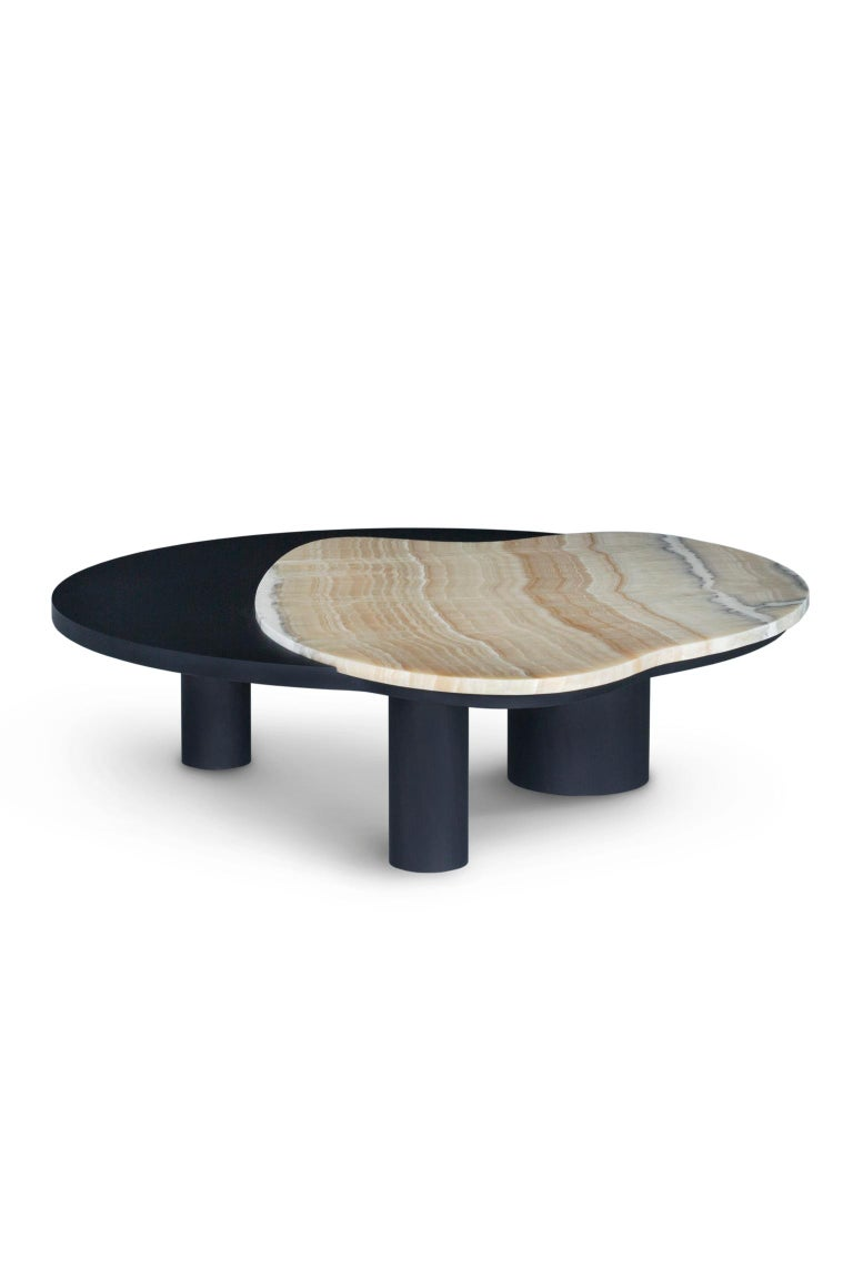 Coffee table with top in American oak veneer, open-pore black stained with matte finish and an inlay detail in polished Shadow onyx. Cylindrical legs in solid beech, black stained with matte finish.  Coffee table Bordeira  WD107 American oak;