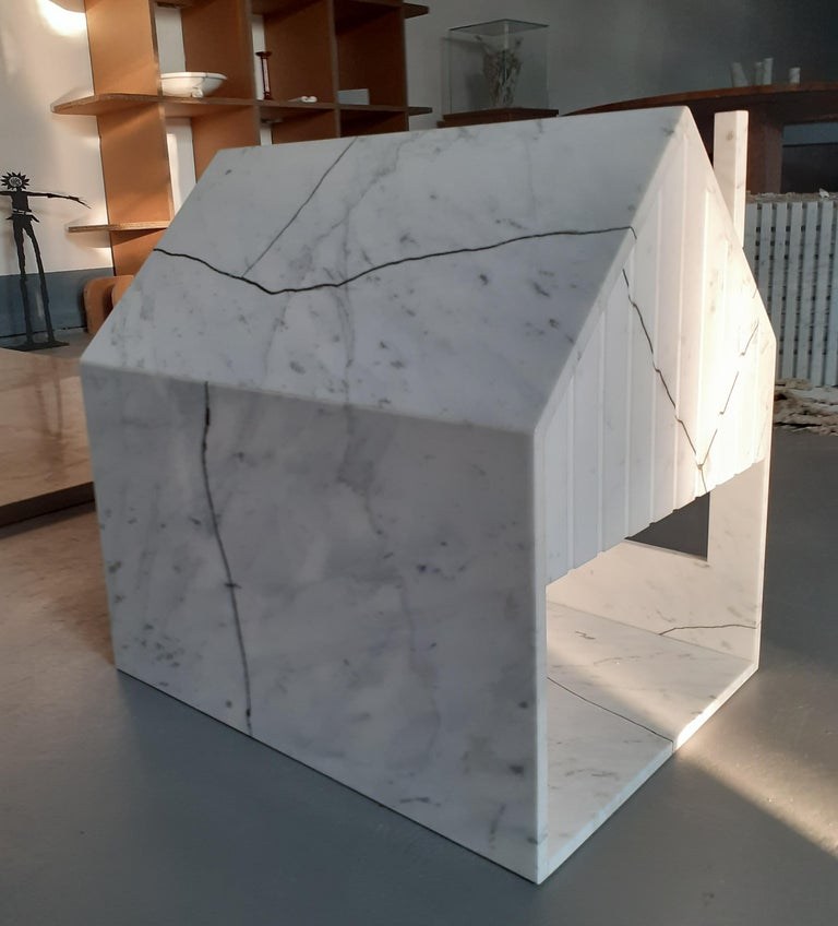 Year 2020 Marble dog house realized with reclaimed Carrara white Statuario & upcycled brass Materials: upcycled brass, reclaimed Carrara white Statuario Size: 38 x 51 x 50 cm.