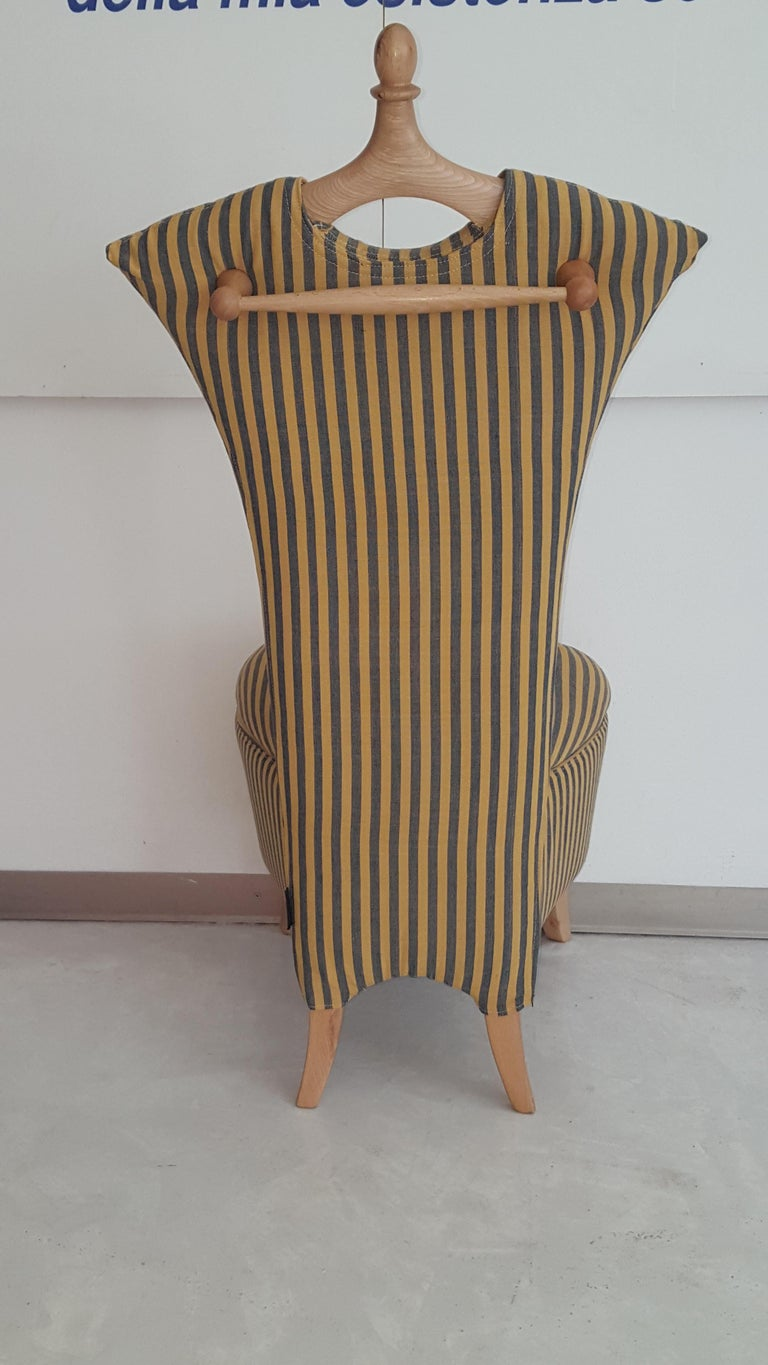 A little service armchair, comfortable and practice, for bedroom and locker rooms. Wooden frame, paddig with shape-retaining polyurethane foam, covered with protective tissue. Opening seatwith containing box. Backrest: coat-hanger  Removable