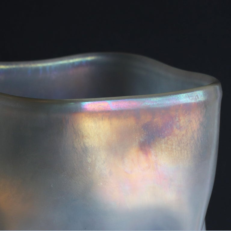 'Twisted' whilst the glass is still malleable and soft, Sacco recalls the shape of a crumpled sack. Once cooled the vase preserves this sense of motion which is further enchanted by the iridescent sheen that follows its curves.  This vase is