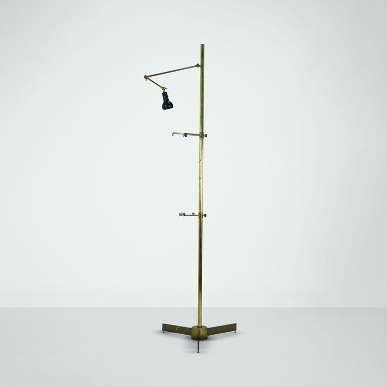 Brass easel floor lamp by Angelo Lelii for Arredoluce. Tripod base with adjustable mounts. Light arm is also adjustable.